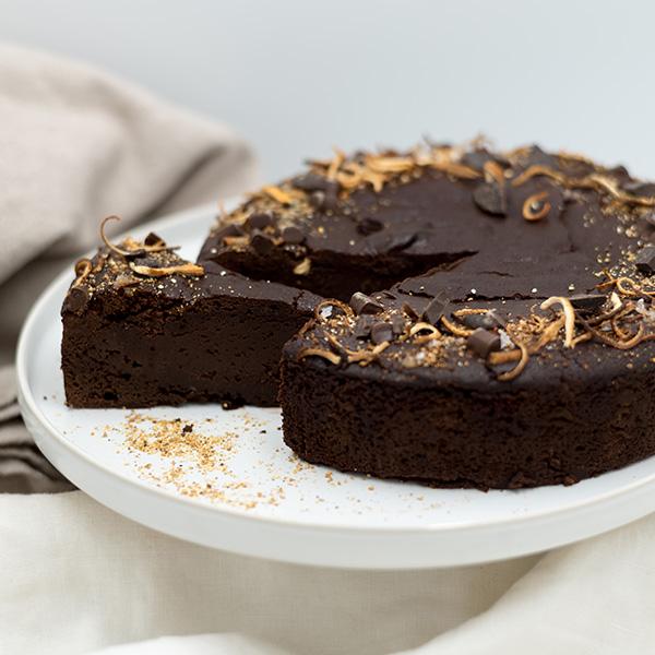 orange flavored chocolate brownie cake with a slice