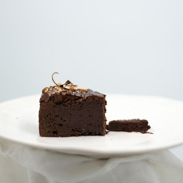 orange flavored chocolate brownie cake slice