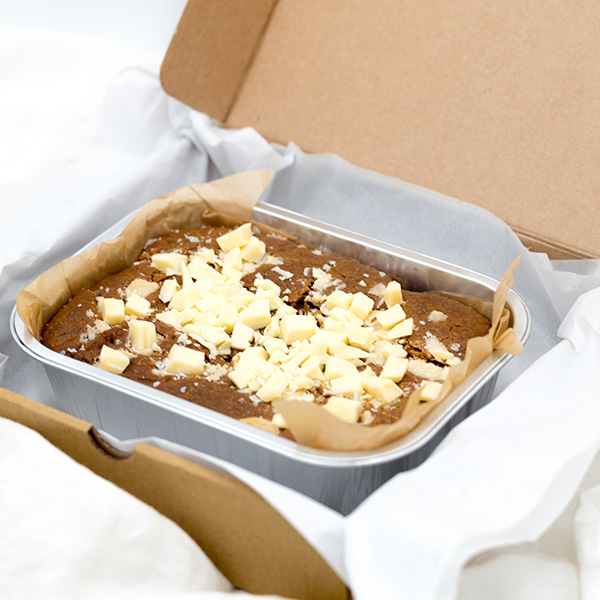 white chocolate topped saled peanut butter brownies in a box